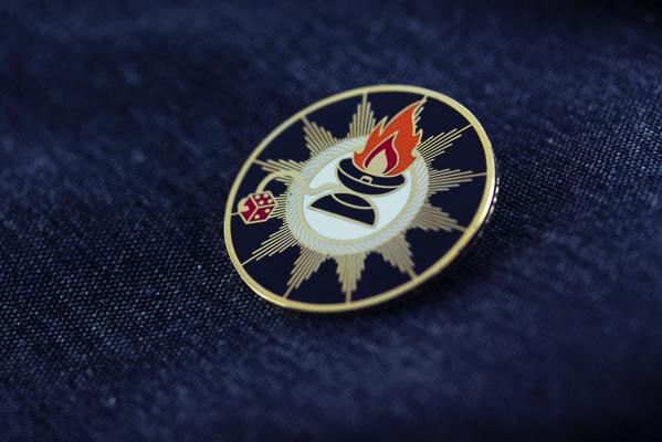 sacred yoyo enamel pin